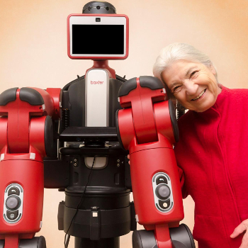 Photo of Ruzena Bajcsy hugging Baxter Robot