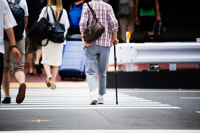 Person with disability crossing the street
