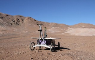 An autonomous rover designed and built by the Robotics Institute drilled into the soil of the Atacama Desert in 2013 and discovered unusual, highly specialized microbes.